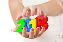 Two Woman Hands Protecting 2018 New Year Sign. Two Woman Hands Protecting 2018 New Year Sign on a white background stock photo