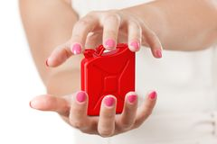 Two Woman Hands Protecting Red Metal Jerrycan. 3d Rendering stock photography