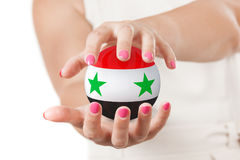 Two Woman Hands Protecting Syria Flag Earth Globe Sphere. Two Woman Hands Protecting Syria Flag Earth Globe Sphere on a white background Royalty Free Stock Images