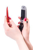 Two woman hands with red and black mobile phone Stock Photo