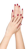 Two woman hands with red fingernail Royalty Free Stock Photography