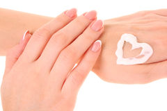 Two woman hands spreading the cream Stock Photography