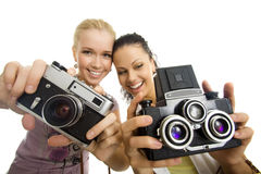 Two woman have fun with camera isolated Stock Photos