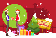 Two Woman Hold Present Box Gift Merry Christmas And Happy New Year. Flat Vector Illustration Royalty Free Stock Image