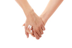 Two woman holding hands Royalty Free Stock Photography