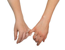 Two woman holding their hands Stock Photos