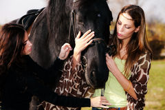 Two woman with horse Stock Images