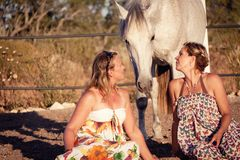 Two woman horse and dog outdoor in summer happy Stock Image