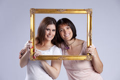 Two woman inside a picture frame Royalty Free Stock Photography