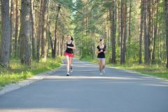 Two woman Jogging in forest Royalty Free Stock Photos