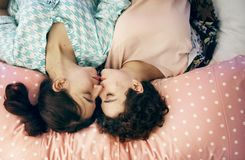 Two Woman Kissing on Bed Royalty Free Stock Photo