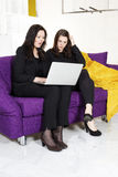 Two woman with laptop Royalty Free Stock Images