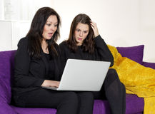 Two woman with laptop Stock Image