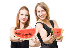 Two woman with lobule of watermelon Stock Photos