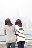 Two woman look somewhere. Two beauty women look somewhere and back to you in hongkong Stock Photography