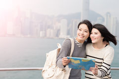 Two woman look somewhere. Two beauty women take map and look somewhere in hongkong Stock Photography