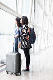 Two woman look somewhere. Two women look somewhere in airport, asian Stock Photography