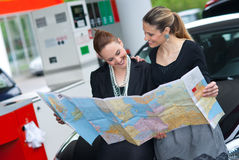 Two woman looking at the map Royalty Free Stock Image