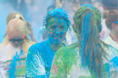 Two woman with lot of blue and green color powder on their cloth Royalty Free Stock Photos