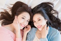 Two woman lying on bed Royalty Free Stock Photo