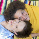 Two woman lying on blanket Stock Images
