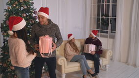 Two woman and man enjoy christmas in house. stock footage