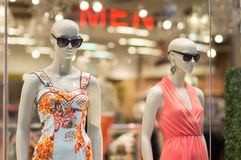 Two woman mannequins in dresses Stock Photos