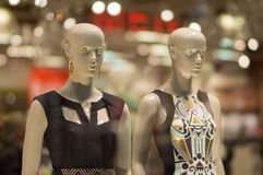 Two woman mannequins in dresses in supermarket. Two woman mannequins in dresses Royalty Free Stock Photos