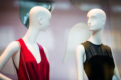 Two woman mannequins in shopping window in store Stock Images