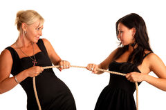 Two woman mother and daughter pull the rope. White background Royalty Free Stock Images