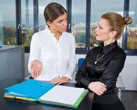 Two woman in office Royalty Free Stock Images