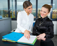 Two woman in office Royalty Free Stock Photos