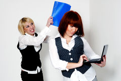 Two woman in office stock image