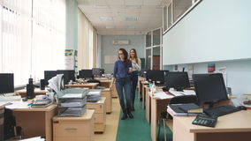 Two woman opetor call center go to the workplace. In office stock video