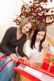 Two woman packing Christmas present Royalty Free Stock Photo