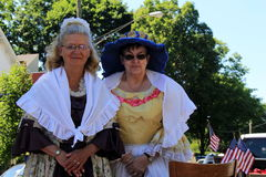 Two woman in period costume, waiting for the holiday parade, Saratoga Springs, New York, 2016 Royalty Free Stock Photography