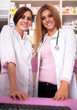 Two woman pharmacist on front desk Royalty Free Stock Photos