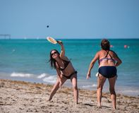 Two woman playing paddleball on the beach stock photos