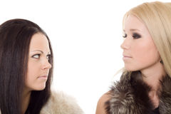 Two woman portrait fur black blond Royalty Free Stock Images