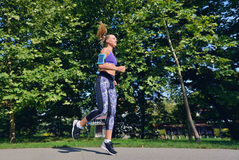Two woman practicing working out - fitness outdoor at the park Royalty Free Stock Image