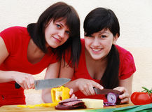 Two Woman Preparing A Meal Royalty Free Stock Photography