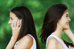 Two woman profile talk phone Royalty Free Stock Photography