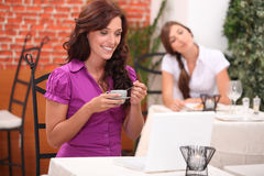 Two woman in restaurant Stock Image