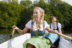 Two woman in a rowing boat Stock Photography