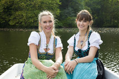 Two woman in a rowing boat Royalty Free Stock Image