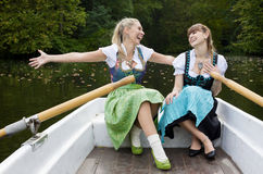 Two woman in a rowing boat Royalty Free Stock Photos