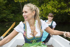 Two woman in a rowing boat Royalty Free Stock Images