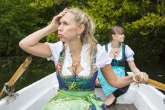 Two woman in a rowing boat Royalty Free Stock Photo
