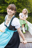 Two woman in a rowing boat Stock Photos