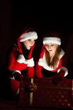 Two woman in Santa costume Stock Photo